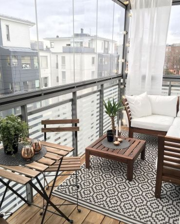 35 Cute Summer Balcony Decor Ideas For Apartment - HOMYFEED #outdoorbalcony Close off with glass